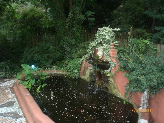 a charming and verdant fountain tucked beside Fabian's