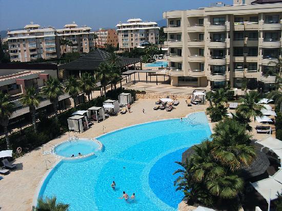 Protur Biomar Gran Hotel & Spa: The pool and swim up bar looking toward one of 2 room blocks.