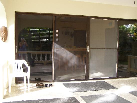 Gatehouse Villa: Kitchen doors from patio adjoining lower bedrooms.