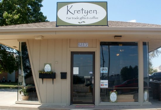 Kretyen LLC: little hut west of Paisanos in Holiday Plaza