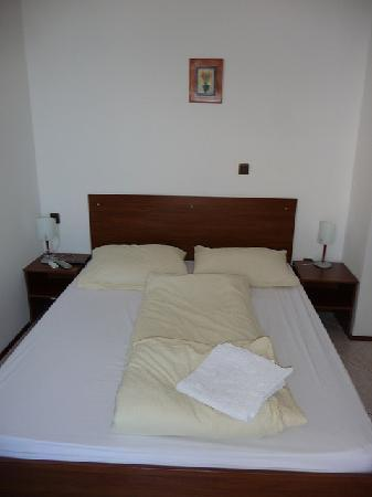 A bed in my room at Villa Katarina