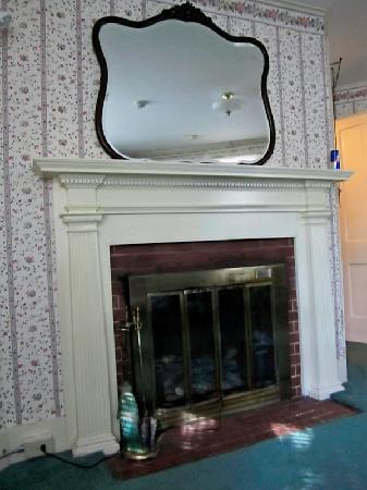 The Village Inn Bed and Breakfast: fireplace in the other room