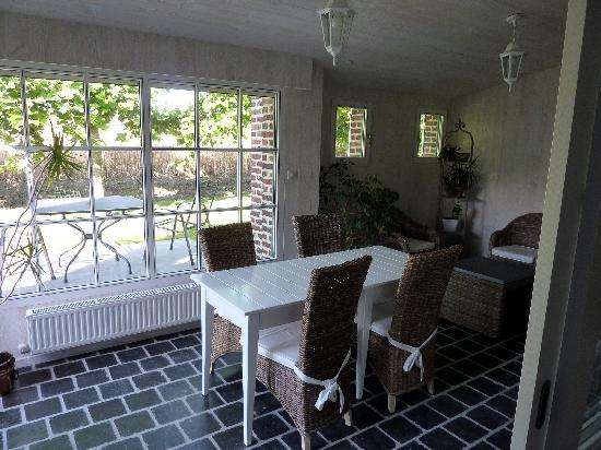 La Ferme des Saules : Indoor and outdoor guest dining areas adjoining guest kitchen