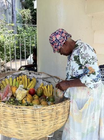 Montego Bay Club Resort: woman selling fruit at bottom of spiral staircase daily