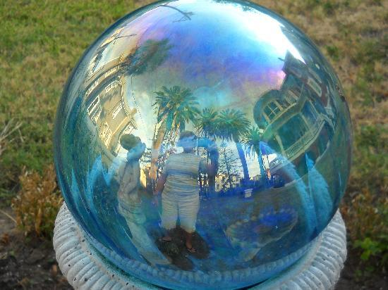 The Victorian Bed & Breakfast Inn: This is the reviewer inside the gazing ball along with a view of mansion and palm trees.