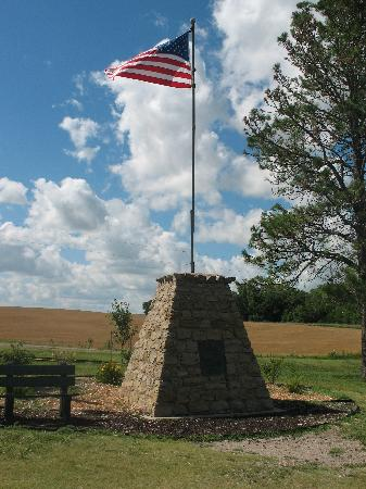 U.S. Center Chapel: The stone marker and flag pole