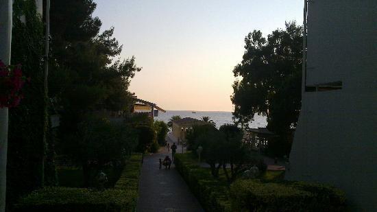 Potidea Palace Hotel: Outside 7xx block - road to the sea and the main restaurant (left)