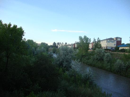 Colorado Springs Extended Stay Hotel: view of back of hotel, walking trail, and creek