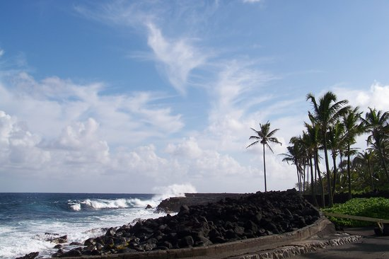Ahalanui Park: The beach at the park.  The rock wall separates the ocean from the calm pool.