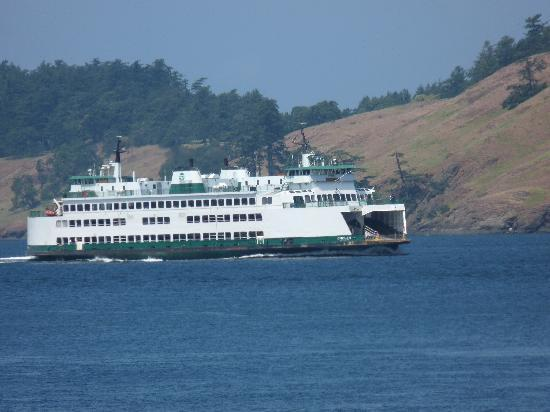 Isla de San Juan, WA: WA State Ferry Passing by Lonesome Cove