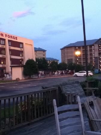 View at dusk of the hotel building and pool area from the deck at Hotel Pigeon Forge.