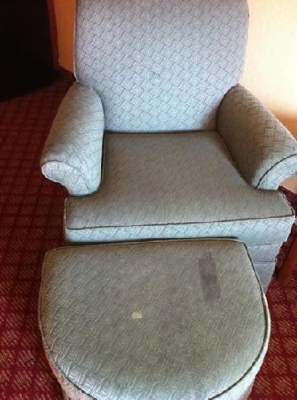 Welcome Hotel and Suites: stained chair and ottoman