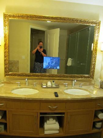 trump hotel las vegas bathroom with tv screen in mirror