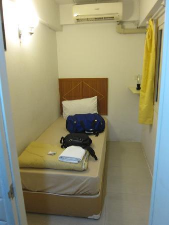 happy guest house: tiny room with bathroom and AC
