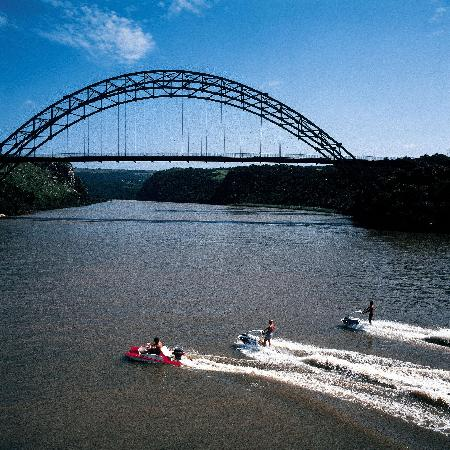 Mangwanani Boutique Spa Wild Coast : Waterworld - jetskiing with a view of the arch bridge over the Umtamvuna River