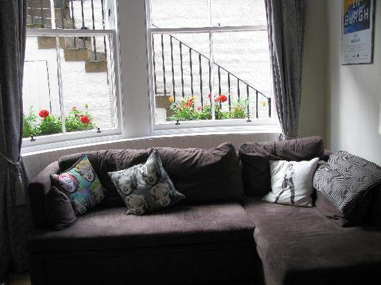 No. 16 Learmonth Terrace: sofa with flat screen TV small Frig just across the hall from kitchen