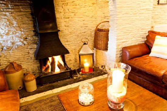 The Swan at Nibley: Our warm and cosy fireplace area