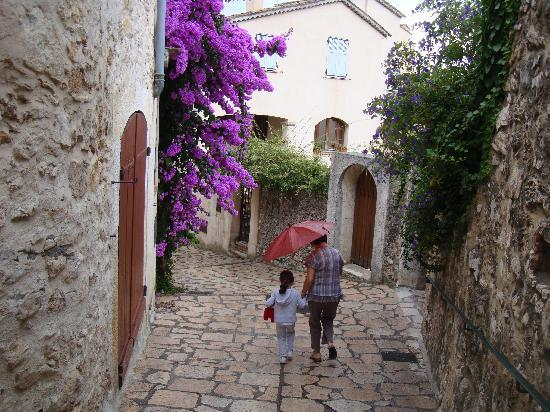 The Frogs' House: Flowers and local woman with grandchild