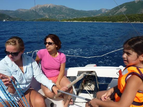 Nidri, Greece: Our 7-yr old daughter having her first sailing lesson by Becky