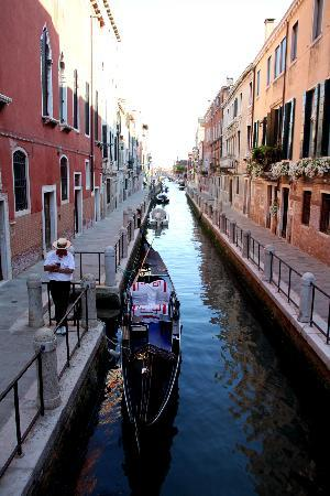 SeeVenice : One of the beautiful canals with a gondolier