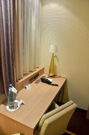 Favored Hotel Domicil: Writing desk (minibar below)