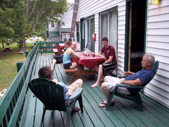 The Elms Waterfront Cottages: Relaxing on the deck