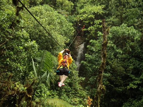 San Luis, Costa Rica: zip line w/waterfall in background