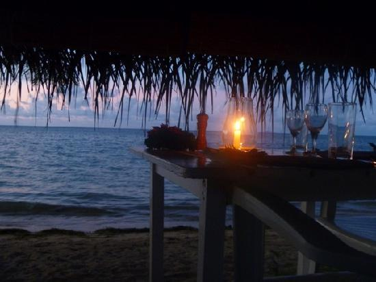 Coconut Grove Beachfront Cottages: Candlelit dinner on the beach