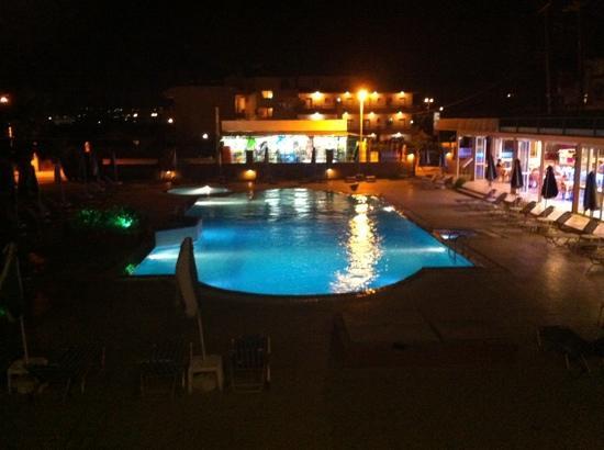 Rhodian Rose Hotel: pool at night
