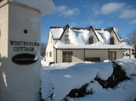 Whitestone Cottages: winter scene with rare snow in village