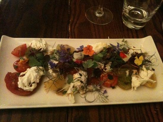 Brilliant tomato and mozzarella starter with edible flowers