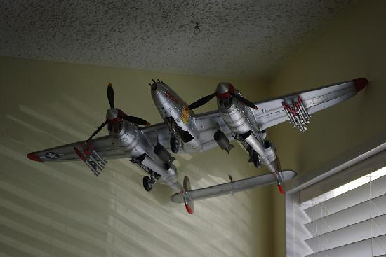 Amelia's Landing Hotel: We stayed in the Lightning Room. This is a model of a P-38 Lightning hanging from our ceiling.