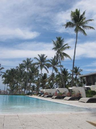 Catalonia Royal Bavaro: View of the infinity pool with the beach palapas in the distance