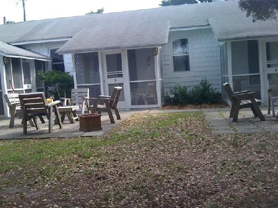 Edwards of Ocracoke: The courtyard taken from the porch swing. The small seating area is where we ate our meals and j
