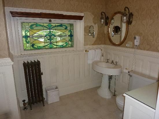 Cornerstone Victorian Bed & Breakfast: the stained glass in the bathroom