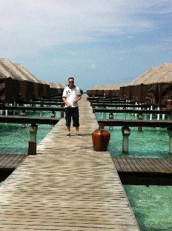 Coco Bodu Hithi: Walkways to the water villas and escape water villas