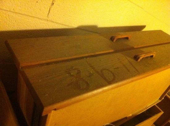 DeSoto Holiday House: dirty furniture stored in the hallway with the date draw in dust.