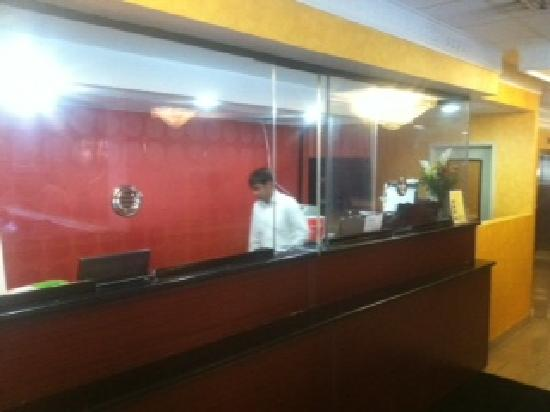Ramada East Orange: Bulletproof glass in the lobby. Serious!