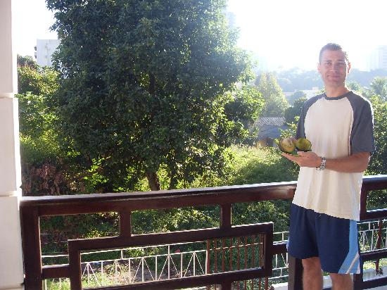 Holding the avacado on the patio of the Supernova Hostel