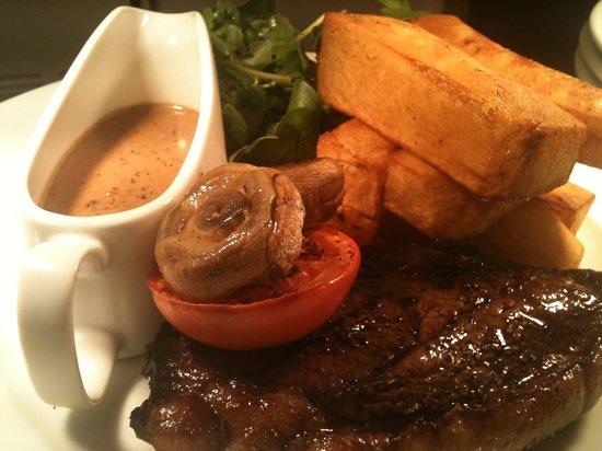 Cucina Cafe Bar & Restaurant: rump steak with peppercorn and homemade hand cut fat chips