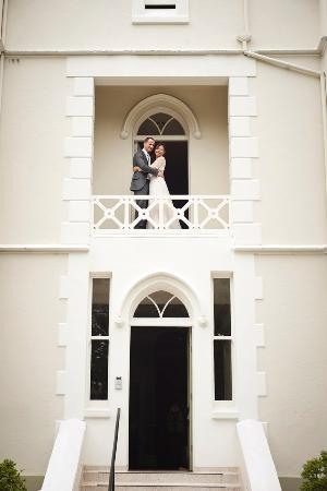 The Green House: Bride and Groom on hotel balcony