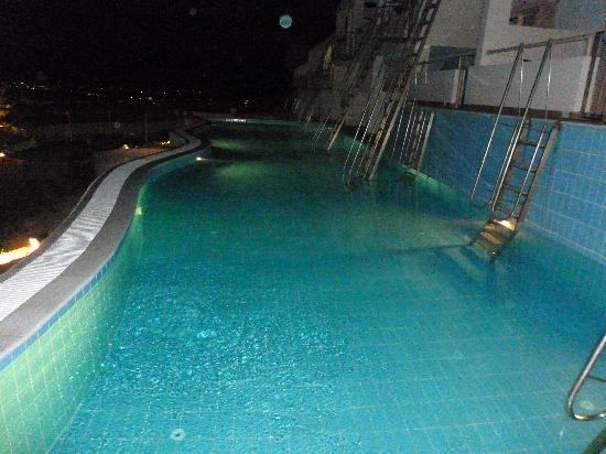 Mitsis Family Village Beach Hotel: Our pool at night