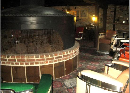 Don Q Inn: Fireplace surrounded by barber chairs