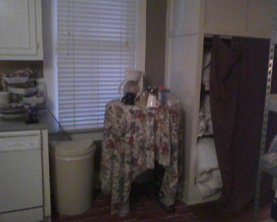"Palmer's Pinckney Inn: Coffee table and shower curtain that ""hides"" the linens.  The curtain was always hanging halfway"