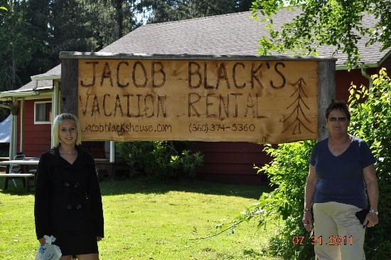 Twilight Tours in Forks: Myself and my granddaughter in front of Jacob's  house.