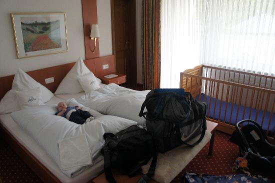 Ringhotel Teutoburger Wald: Our double room with our baby son testing the bed