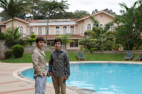 House of Waine : My sons in the beautiful garden of the hotel