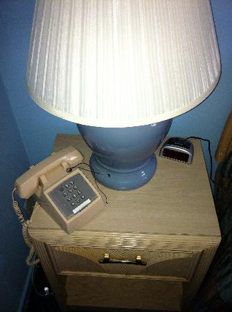 Sail Inn of Montauk: nightstand with non-working lamp and mystery phone