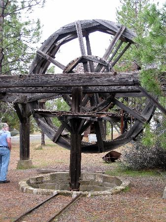 """Yreka - Greenhorn Park - old mining equipment; """"ghost town"""" visible behind"""
