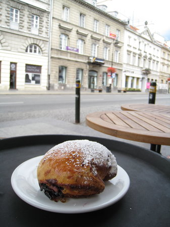 Vincent Cafe : Delightful Polish speciality, a filled doughnut (pączka), but dusted with confectioner's sugar r